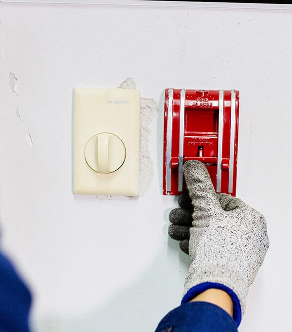 Test the fire alarm pushbutton